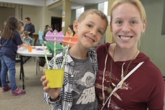 Trinity kid with crafts at Sunday School Finale